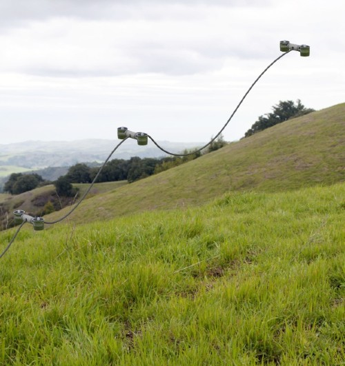 Rendering of a multi-drone thether system on a green hill